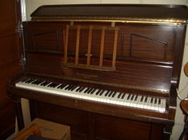 'Nana's' piano. Actually ours, with the theme tune played honky tonk style by my partner Tim (because the piano was in the garage back then!)