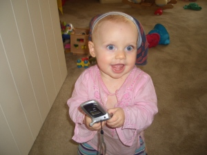 Kaya employs tactile and visual learning here - wearing her brother's undies on her head and mum's old phone safe in hand!