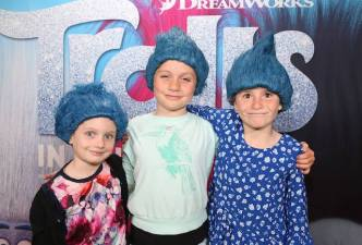 Kids at Trolls Premiere wearing blue wigs